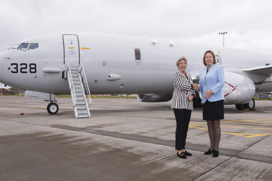 Minister of Defence Procurement Anne-Marie Trevelyan MP and Ms Tone Skogen, the Norwegian State Secretary in the Minitry of Defence at the front of a US Navy Poseidon P8-A aircraft before their flight.