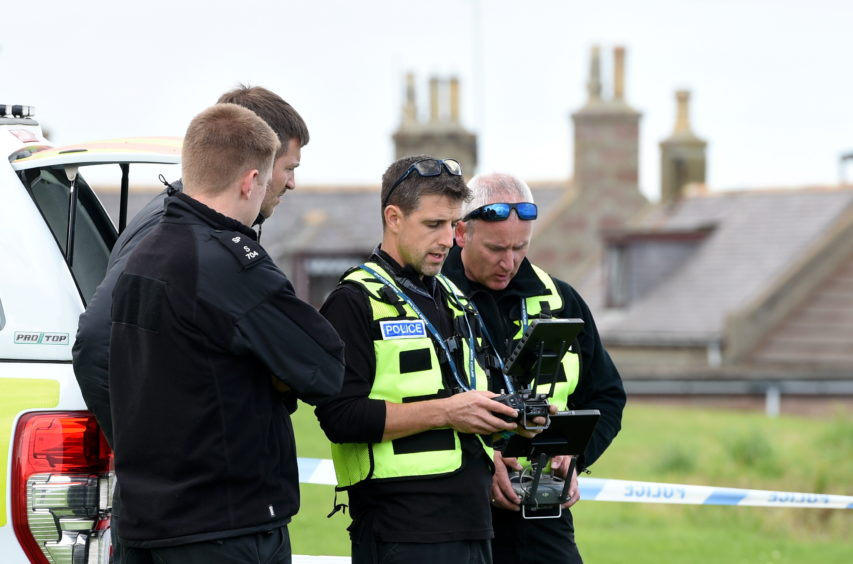 Police officers using a drone at Gadle Braes in Peterhead.