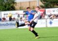 Cove Rangers' Jamie Redman and Edinburgh's Blair Henderson.