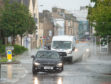 Cars struggled to make it through the deluge in Elgin.
