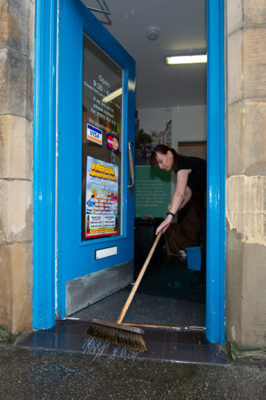 Rebecca Mayne from Easy Removals cleaning up following the rain