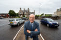 Councillor George Alexander at the junction of Orchard Road and St Catrherine's road in Forres.