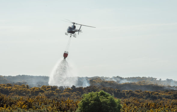 Helicopters were used to douse flames between Lossiemouth and Hopeman. Picture by Jason Hedges.