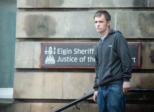 Alexander McPhee leaving Elgin Sheriff Court.