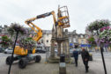 Pictures by JASON HEDGES     [LOCATOR] Survery of the Market Cross in Forres is being carried out today.  Pictures by JASON HEDGES