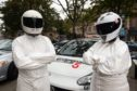 Martin Rush, Left and Erin Keith, right are pictured as Stigs from Top Gear Picture by JASON HEDGES