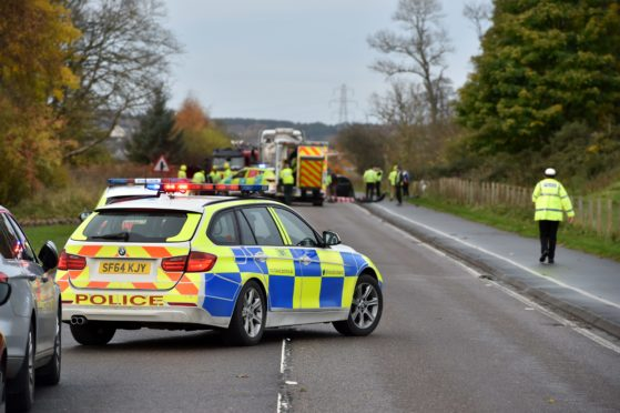 Police at the crash site on the A96 between Lhanbryde and Elgin.