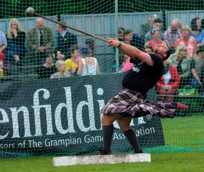 Kyle Randalls during the Hammer throw.  Picture by KENNY ELRICK