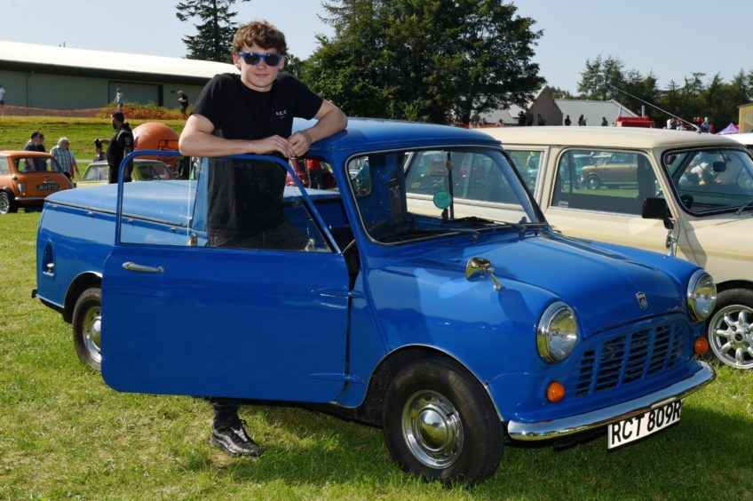 Lewis Walker with his 1976 Mini pickup.  Picture by KENNY ELRICK