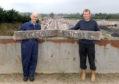 Raymond Sharp and his son Doug Sharp with two original Kintore Railway Station signs.