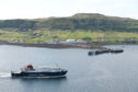 The Caledonian MacBrayne ferry 'Hebrides' arrives in Uig on Skye from Tarbert on Harris.