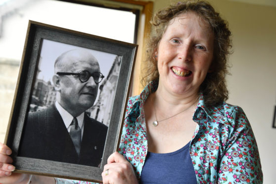 Jennie Milne with a photograph of her grandfather Stanislaw Lis, a Polish war hero.