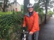 Reverend Robert Brookes getting ready for his cycle challenge.