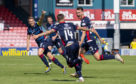 03/08/19 LADBROKES PREMIERSHIP ROSS COUNTY v HAMILTON ACADEMICAL GLOBAL ENERGY STADIUM - DINGWALL Ross County's Joe Chalmers celebrates making it 1-0 with teammates