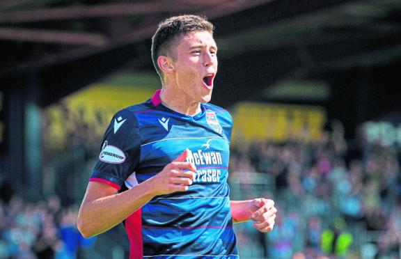 Ross County's Ross Stewart celebrates scoring against Hamilton.