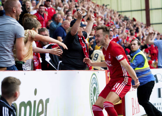 Ryan Hedges celebrates with the home support after making it 3-2 to Aberdeen.