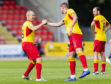 Partick's Kenny Millar (L) celebrates his equalizer with teammate Sean McGinty