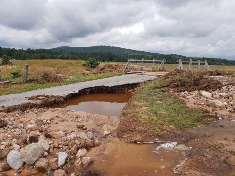 Flood damaged car park at Dalnahaitnach