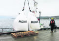 Bags of feed being loaded at Mowi's new salmon feed plant at Kyleakin on Skye, where checks are being carried out