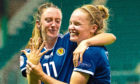 Lisa Evans (L) shares a joke with Kim Little following victory over Cyprus