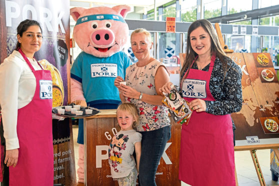 Customers Gillian Gove and daughter Billie Gray joined Aberdeenshire farmer Lynn Argo (far right) and one of the Specially Selected Pork brand ambassadors at Lidl in Aberdeen.