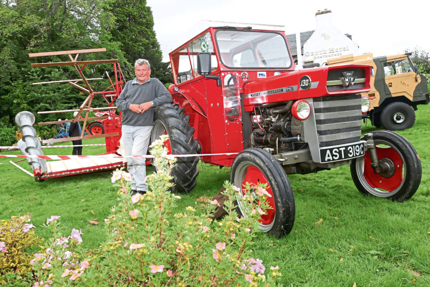 Gordie Green from Cromdale with a Massey Ferguson 130 tractor and corn/barley binder.