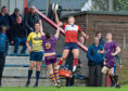 CR0013452 First round of the Scottish Cup - Aberdeen Grammar (red) v Marr RFC (purple) at Rubislaw. Picture of Nathan Brown jumping for the ball.  Picture by KENNY ELRICK     31/08/2019