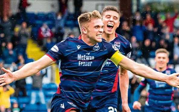 Ross County's Marcus Fraser celebrates his goal with Ross Stewart (R) during the Ladbrokes Premiership match between Ross County and St. Mirren