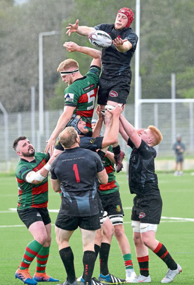 Oscar Baird for Highland tries to get this lineout ball but is beaten by Biggar. Picture by Sandy McCook