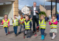 Moray MSP Richard Lochhead joins the children from the Curious Minds nursery on their litter pick.