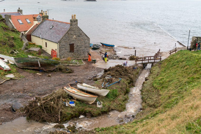 Locals clearing the damage in Crovie
