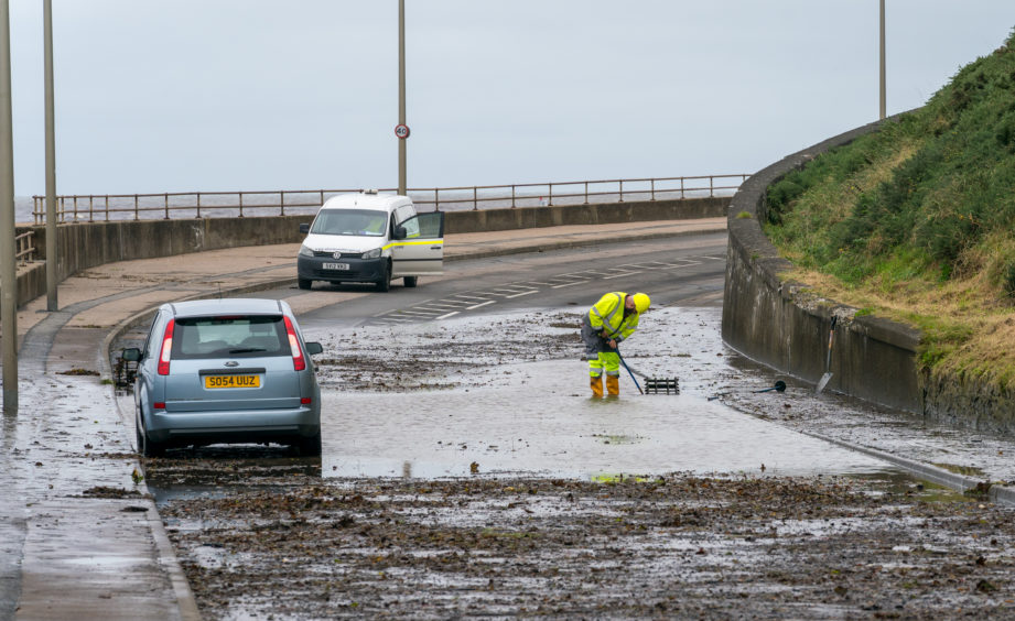 Aberdeenshire Council working at the scene of the flooded area between Banff Bridge and Macduff