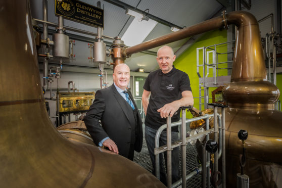David Taylor, HIE account manager is pictured with Duncan Tait distillery manager at Glenwyvis Distillery.