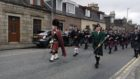 The pipe band parade through Inverurie