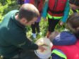 A fisheries officer for the River Dee Trust helps youngsters get up close and personal with some of the animals that live in the river.