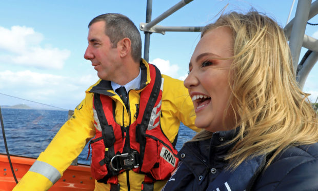 Kerrie at helm of Oban Lifeboat