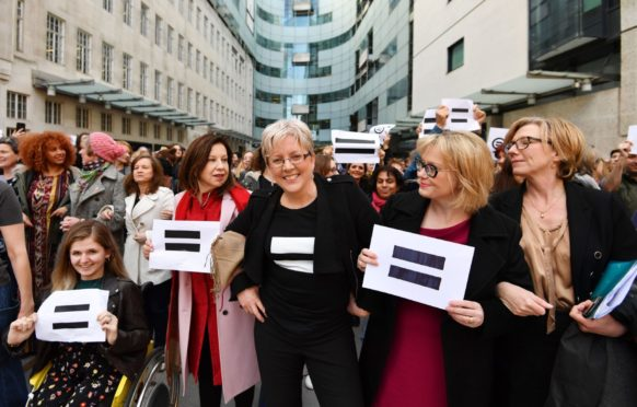 Journalist Carrie Gracie (centre) and BBC employees gather outside Broadcasting House in London, to highlight equal pay on International Women's Day. PRESS ASSOCIATION Photo. Picture date: Thursday March 8, 2018. See PA story MEDIA Women. Photo credit should read: John Stillwell/PA Wire