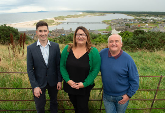 Huw Williams, development officer for Lossiemouth Community Development Trust, Moray Council convener Shona Morrison and Rab Forbes, chairman of Lossiemouth Community Development Trust's bridge committee.