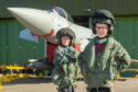 RAF Lossiemouth host an event for primary school pupils to showcase how science and technology subjects can apply to jobs Children take part in activities at the base to learn how the subjects apply to roles. Picture: Abigail Campbell from Cullen Primary and David Wallace from Dallas Primary