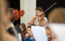 Scottish Symphony Orchestra Amy Cardigan on her violin Pictures and video by JASON HEDGES