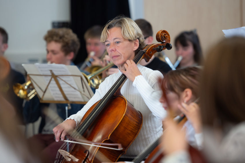 Scottish Symphony Orchestra Anne Brincourt on her cello Pictures by JASON HEDGES