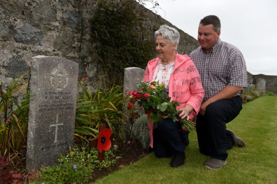 Louise Kurtz and son Jeffery Kurtz from Canada, visited the grave of her uncle who was sergeant Willaim McAdam, the first man to be killed flying over Peterhead in 1941 who is buried at Longside cemetery after crashing at a farm near Crimond.   Picture by KENNY ELRICK     03/09/2019