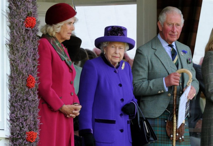 Picture of (L-R) Camilla Duchess of Rothesay, The Queen and Prince Charles watching the games.  Picture by KENNY ELRICK