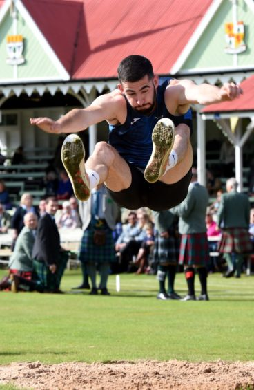 Andrew Murphy during the long jump.  Picture by KENNY ELRICK