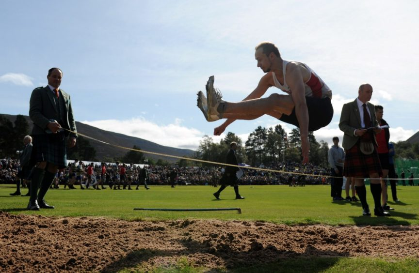 Allan Hamilton competing in the long jump.  Picture by KENNY ELRICK