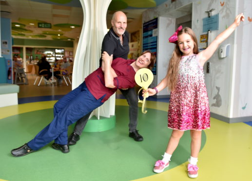 Lucy Stewart, pictured right, with clinical nurse manager Julie Mulliner and Aberdeen Maternity Hospital theatre team lead David Imison.    Picture by Scott Baxter    04/07/2019