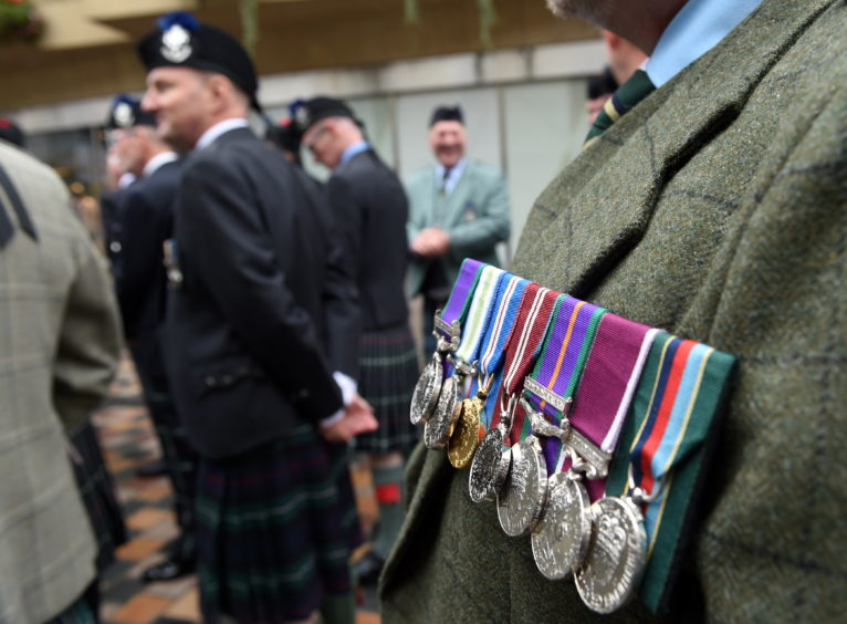 Military personnel of all ages turned out to honour the regiment. Picture by Sandy McCook