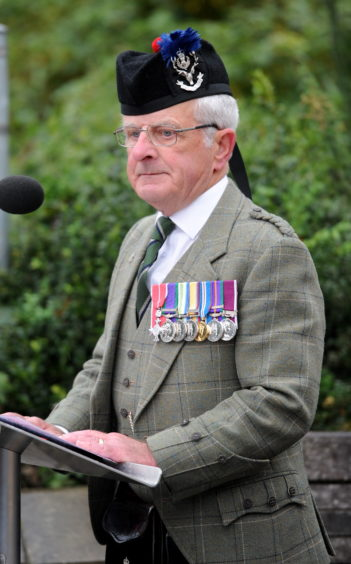 Lieutenant Colonel Bob Towns MBE reads aloud the names of the 14 men who gave the ultimate sacrifice. Picture by Sandy McCook