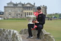 Denmarks Lucas Bjerregaard with the Alfred Dunhill Links trophy on the Swilken Bridge.