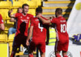 Aberdeen's Andrew Considine (centre) celebrates his goal at Livingston
